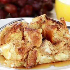 Up close image of french bread casserole drenched in syrup