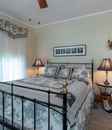 A room painted white with white sheets looks clean and inviting